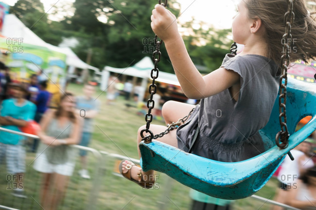 Girl on a swing ride at a fair