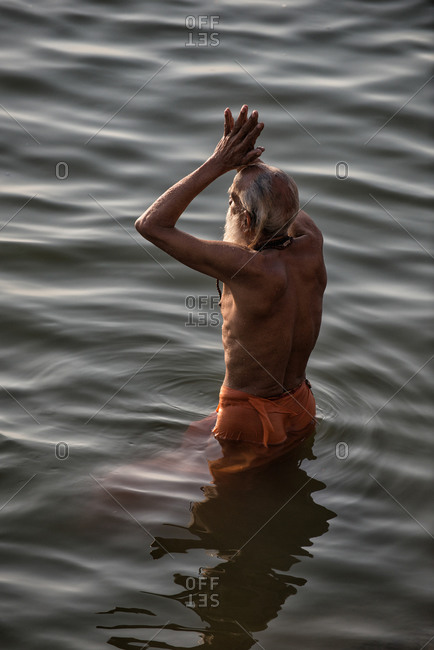 Holy man praying in the Ganges River
