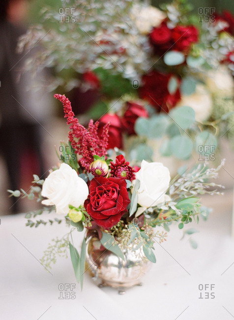 Red and white wedding flower arrangement