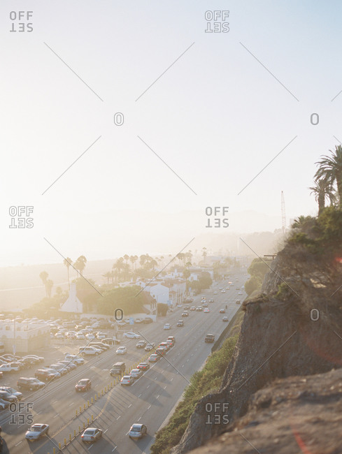 Overlooking a beachfront freeway with traffic from a cliff