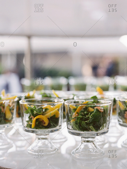 Close-up of individual dishes of green salad at banquet