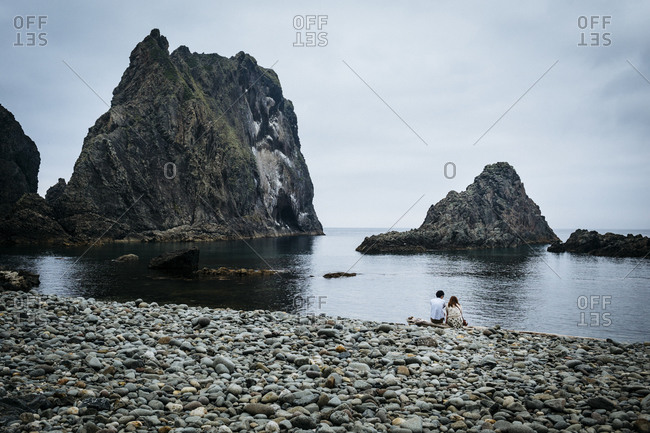 Couple on beach on Shakotan Peninsula in Japan