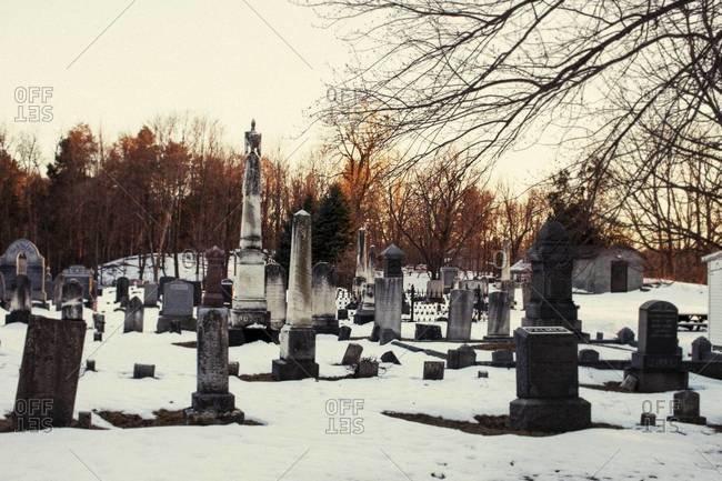Snowy graveyard at sunset - Offset