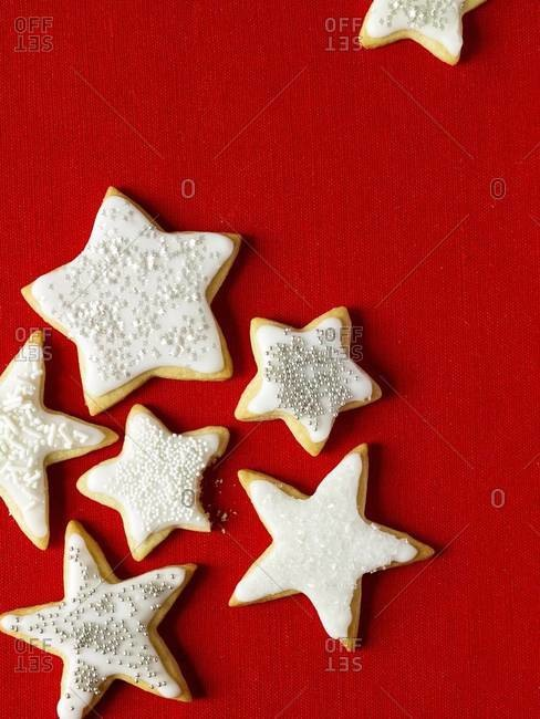 Star-shaped sugar cookies with icing and sprinkles