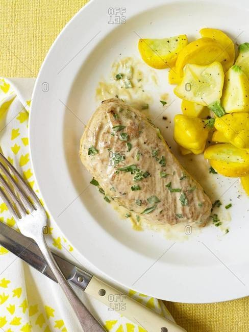 Dijon chicken and yellow squash on a plate