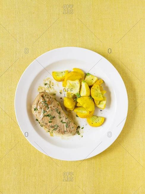 Plate of dijon chicken and yellow squash