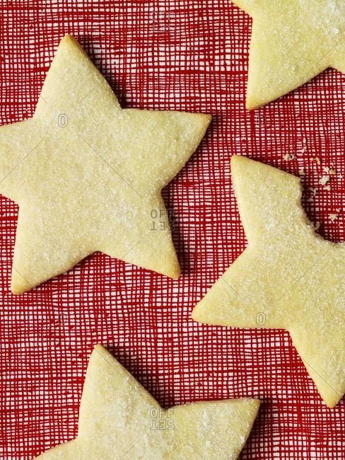 Star-shaped sugar cookies on a red background