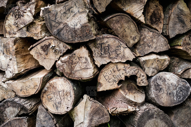 A neatly stacked pile of logs, a firewood log store