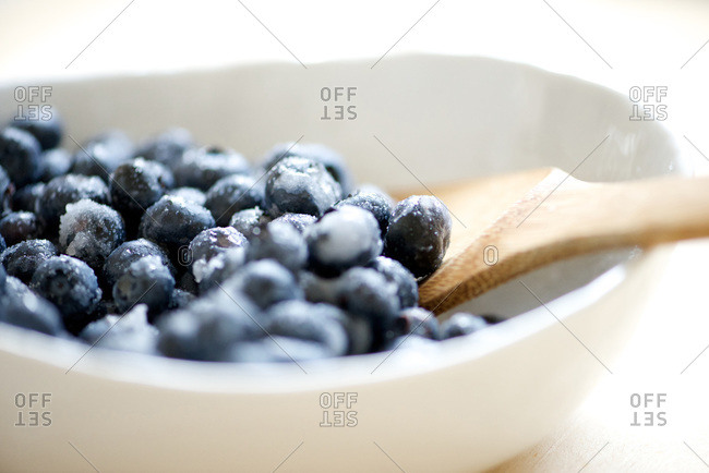 White bowl full of fresh blueberries