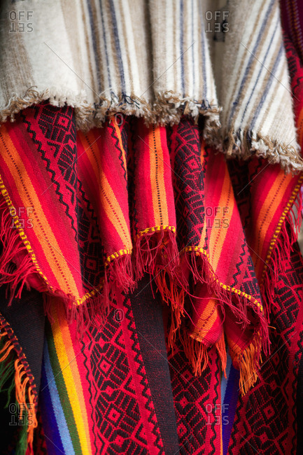 Colorful woven cloth hanging in a market in Lima, Peru