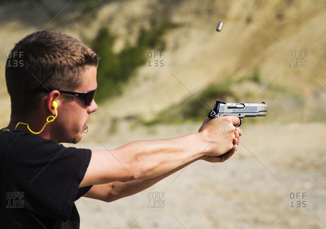 Man shooting handgun - Offset Collection