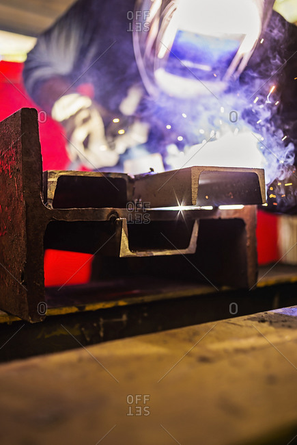 Gleaming piece of metal being welded