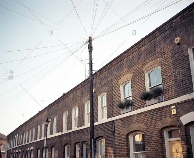 Electricity pole in front of brick building