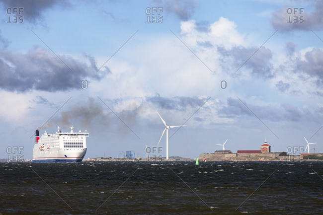 Gothenburg, Sweden - May 3, 2012: Ship on sea passing turbines