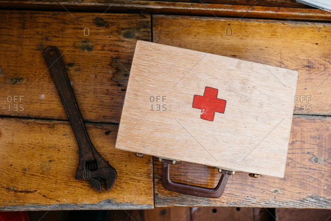 Wrench and first aid kit on a boat