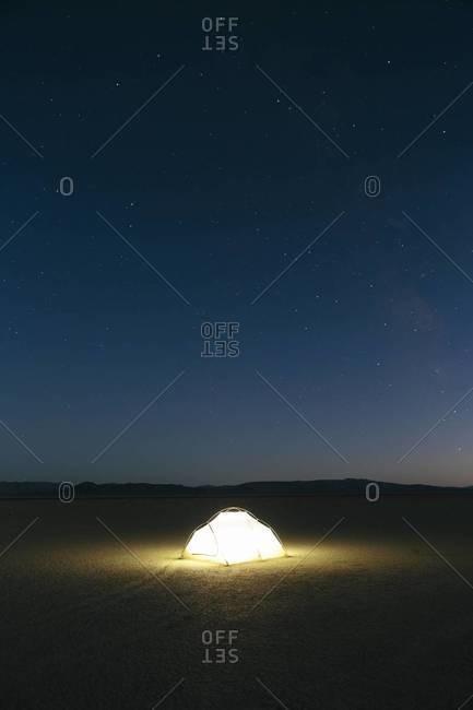Illuminated campsite at night in Black Rock Desert, Nevada