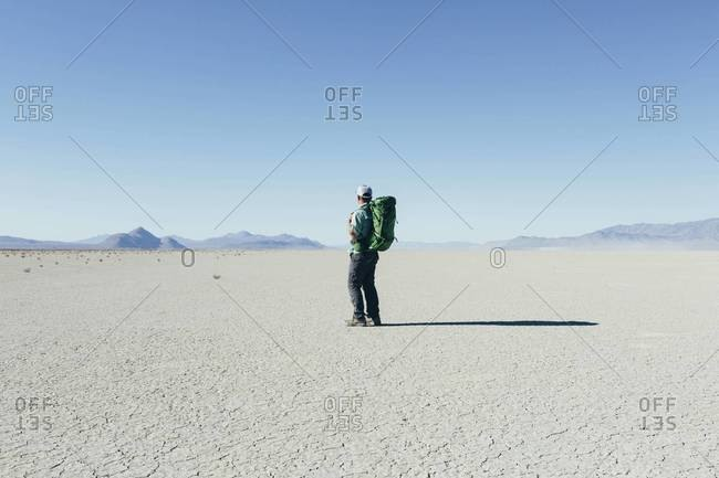 Middle aged man backpacking in the Black Rock Desert, Nevada