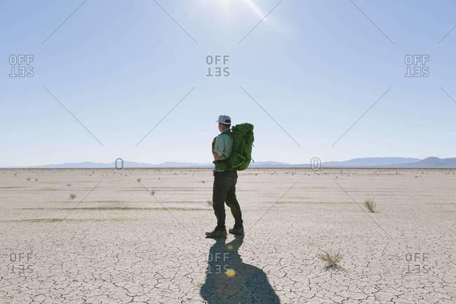 Middle aged backpacker in the Black Rock Desert, Nevada