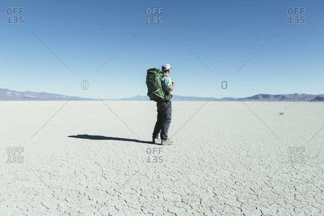Middle aged man hiking in the Black Rock Desert, Nevada