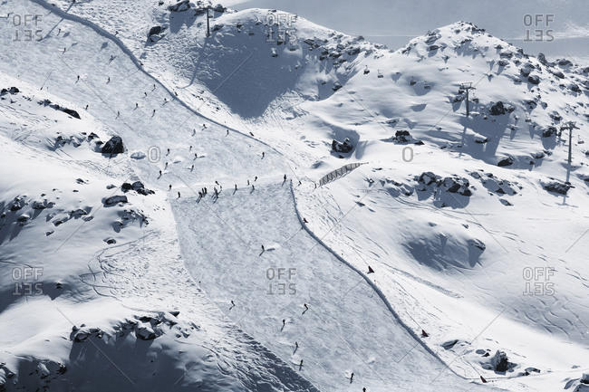 Skiers on slope in winter landscape, Ischgl, Tyrol
