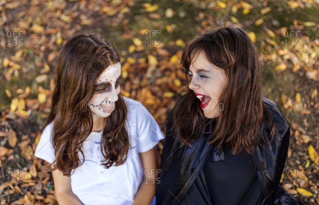 Two masquerade girls at Halloween