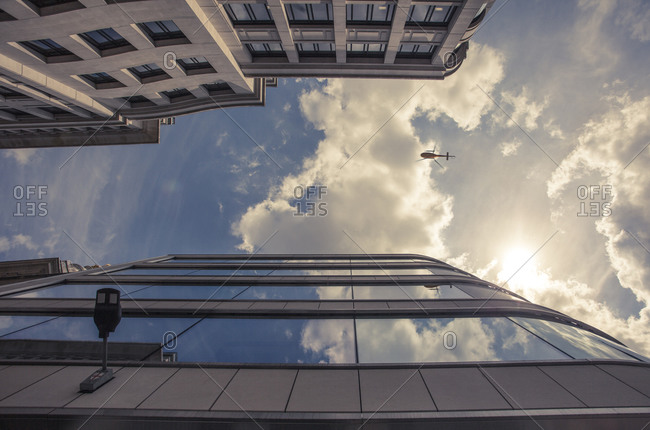 Facades of office towers at financial district and helicopter seen from below, London