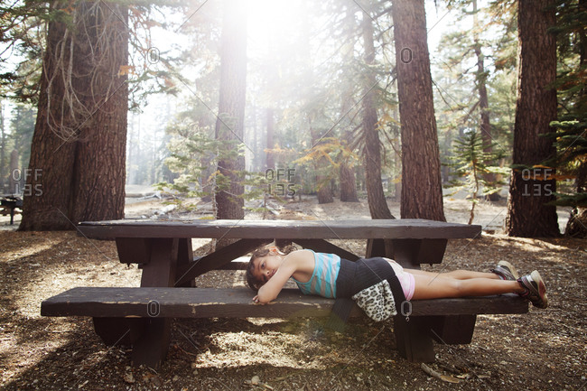 Girl taking a rest at a forest picnic area