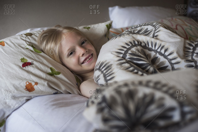 Young kid lying in bed