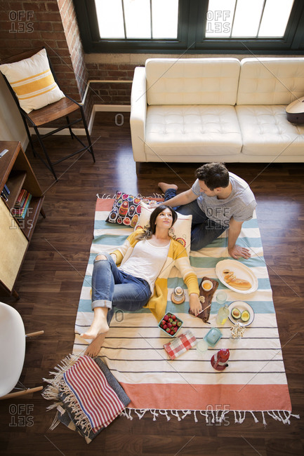 Couple having a picnic inside their home