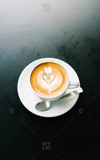 Coffee drink with heart shape in foam