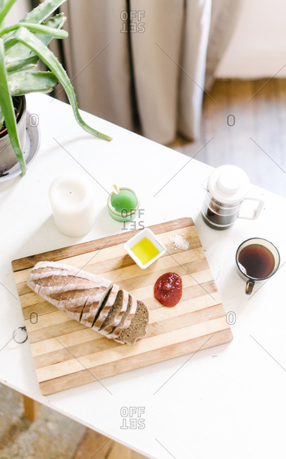 Bread loaf with various dips and coffee