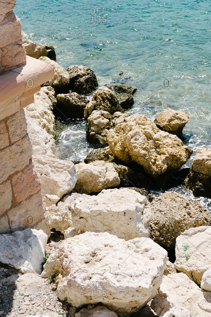Rocky coast and foundation of old fort in Marseille, France