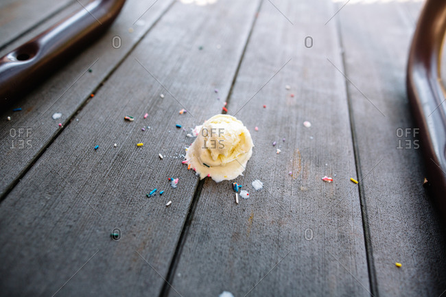 A scoop of ice cream dropped on the ground