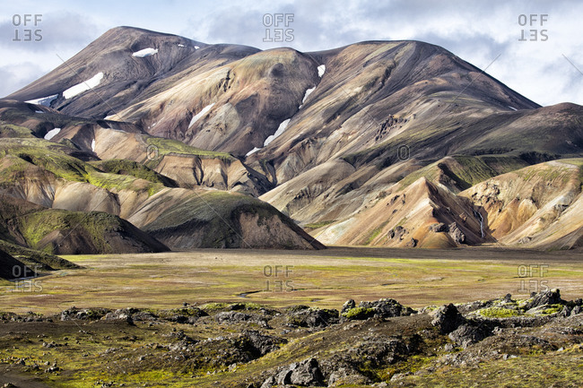 Distant mountains across a grassy plain at Landmannalaugar, Iceland