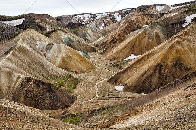 Dry riverbed between mountains at Landmannalaugar, Iceland