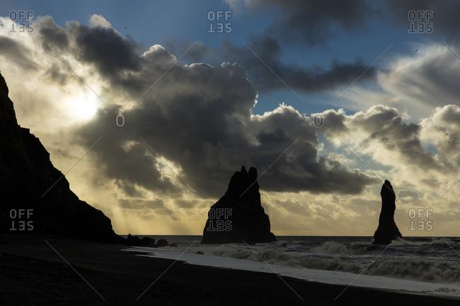 Basalt sea stacks on the coast of Iceland at sunset