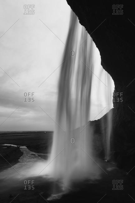 Underside of Slejalandsfoss waterfall in Iceland
