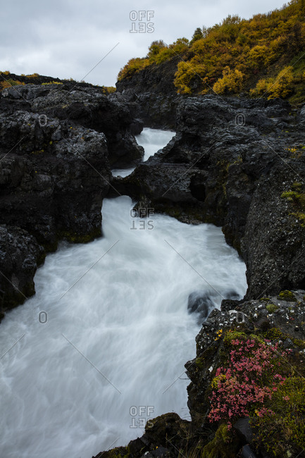 Barnafossar Waterfall flowing through a rocky landscape in Iceland