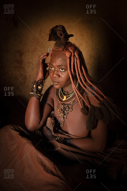 August 20, 2015: Himba woman taking a smoke bath in Namibia