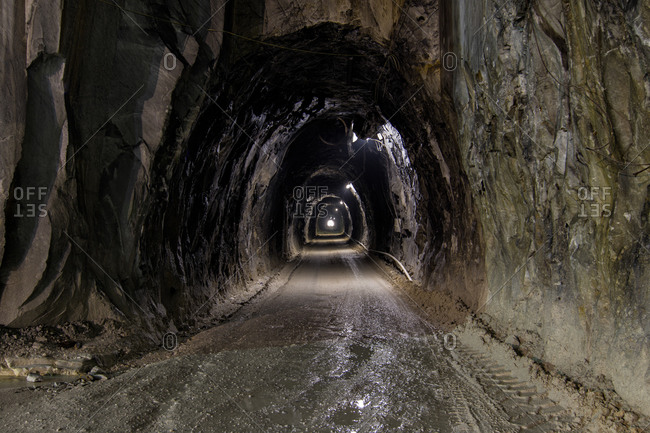 Tunnel in marble quarry in Tuscany, Italy