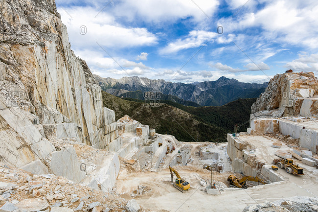 Equipment working in a marble quarry in mountains, Tuscany, Italy