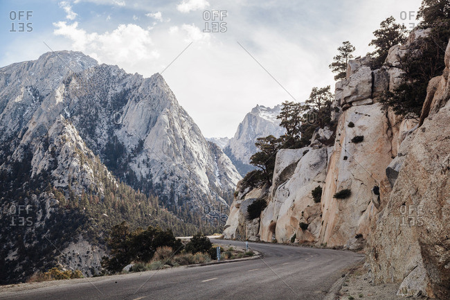 Empty highway curving through mountains