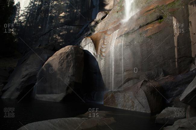 Waterfall cascading down a steep stone wall