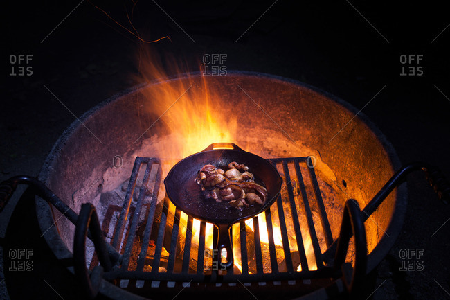 Bacon cooking on an outdoor grill