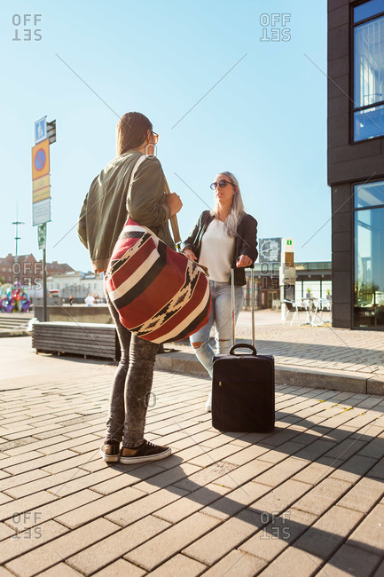 Female travelers with their baggage in Malmo, Sweden