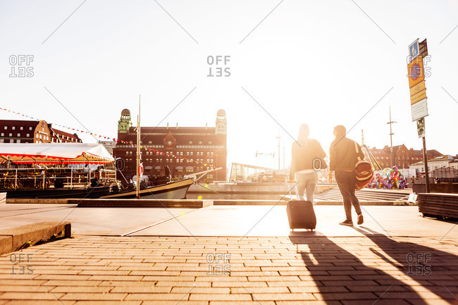 Female travelers walking with their bags in Malmo, Sweden