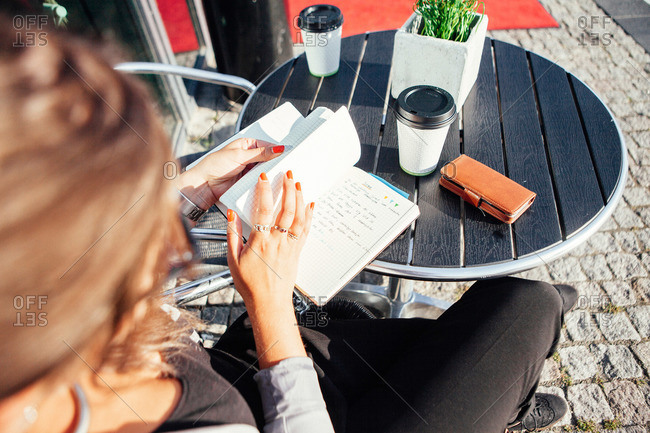 Woman with a notebook at a cafe in Malmo, Sweden