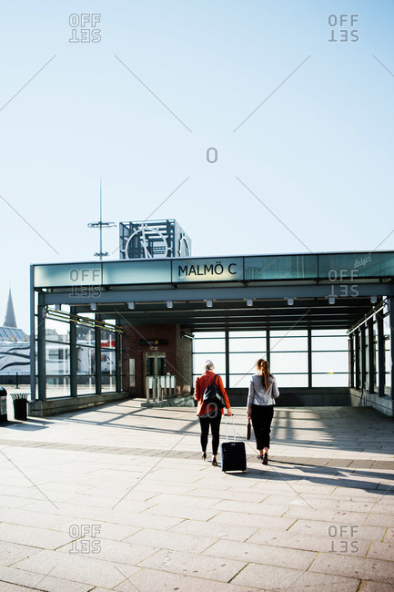 Women with luggage at a Malmo train station in Sweden