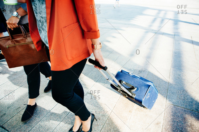 Woman with luggage in Malmo, Sweden