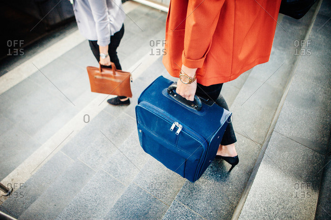 Women walking down stairs with luggage in Malmo, Sweden
